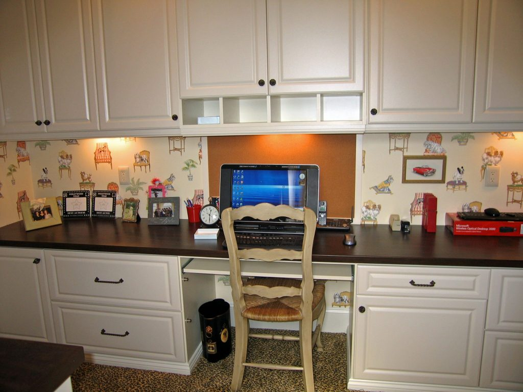 Custom designed and custom built home offices by Closets and Things.